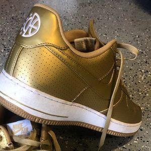 Nike Air Force1. Gold/White metallic.